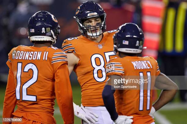 Chicago Bears tight end Cole Kmet chats with Chicago Bears wide receiver Allen Robinson and Chicago Bears wide receiver Darnell Mooney in action...