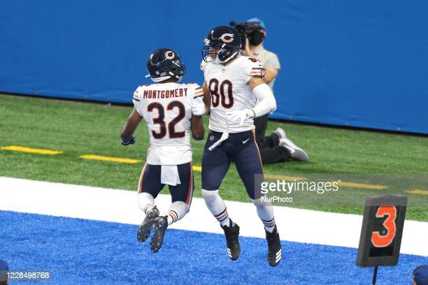 Chicago Bears tight end Jimmy Graham celebrates with running back David Montgomery after scoring a touchdown against the Detroit Lions during the...