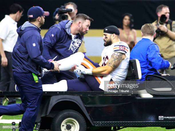 Chicago Bears tight end Zach Miller holds his leg as he is carted off the field following his injury during the second half of their game against the...