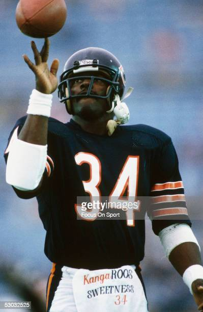 Chicago Bears' Walter Payton twirls a football on his finger during a game.