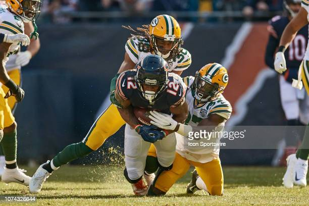 Chicago Bears wide receiver Allen Robinson is tackled by Green Bay Packers cornerback Tramon Williams and Green Bay Packers cornerback Josh Jackson...