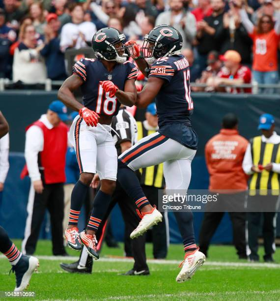 Chicago Bears wide receiver Allen Robinson , right, celebrates his touchdown with Chicago Bears wide receiver Taylor Gabriel during the first half...