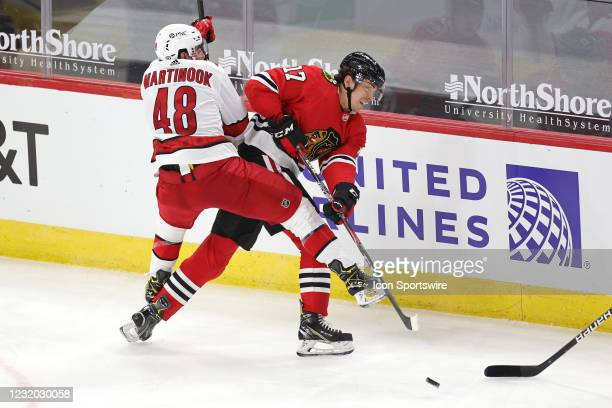 Chicago Bears wide receiver Anthony Miller battles with Carolina Hurricanes left wing Jordan Martinook in action during a game between the Chicago...