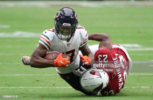 Chicago Bears wide receiver Anthony Miller is tackled by Arizona Cardinals defensive back Bene Benwikere in the first quarter on Sunday Sept 23 2018...