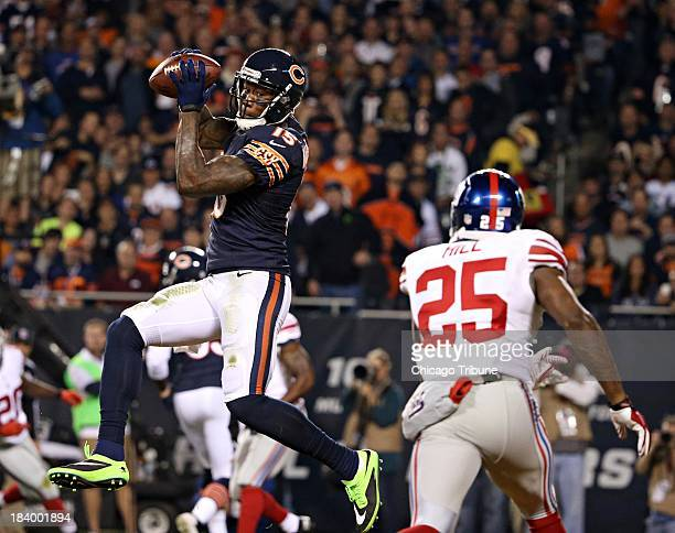 Chicago Bears wide receiver Brandon Marshall catches a touchdown over New York Giants defensive back Will Hill in the second quarter at Soldier Field...