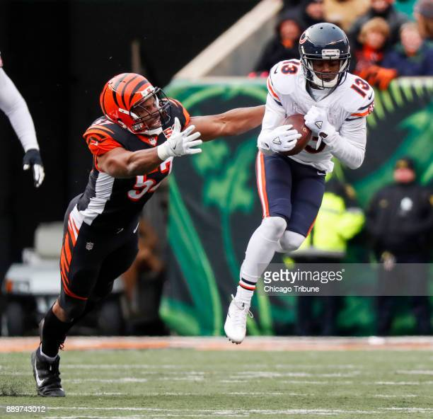 Chicago Bears wide receiver Kendall Wright catches the ball for a first down in front of Cincinnati Bengals outside linebacker Vincent Rey in the...
