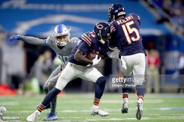 Chicago Bears wide receiver Kendall Wright looks to run the ball against Detroit Lions cornerback Teez Tabor during the second half at Ford Field on...