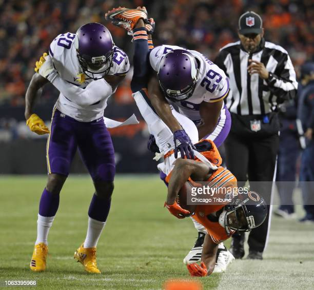 Chicago Bears wide receiver Taylor Gabriel is flipped out of bounds on a tackle by Minnesota Vikings cornerback Xavier Rhodes in the first quarter on...