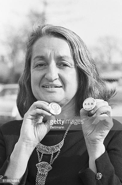 Mrs Betty Friedan president of the National Organization for Women holds equality for women button at meeting during the organization's 4th annual...