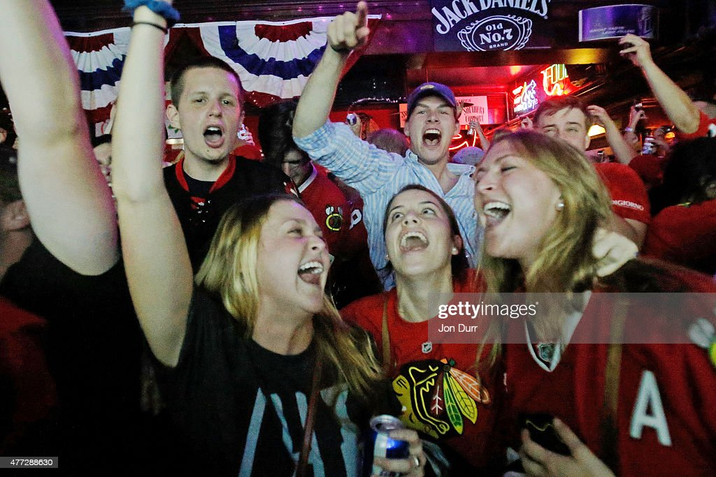 Chicago Blackhawk fans celebrate a goal during Game Six of the NHL 2015 Stanley Cup Final at Sluggers World Class Sports Bar on June 15, 2015 in Chicago, Illinois. The Blackhawks beat the Lightning 2 - 0 to win the Stanley Cup.