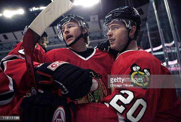Chicago Blackhawks' Andy Hilbert celebrates the first of two first period goals with teammate Matthew Barnaby against the Pittsburgh Penguins during...