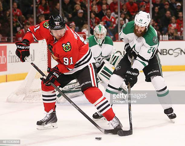 Chicago Blackhawks center Brad Richards controls the puck in front of Dallas Stars defenseman Jordie Benn during the first period on Sunday Jan 4 at...