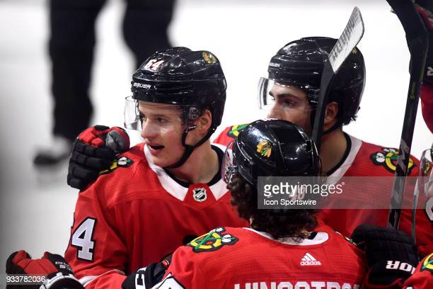 Chicago Blackhawks center David Kampf celebrates with teammates after scoring a goal in the second period of play during a game between the Chicago...