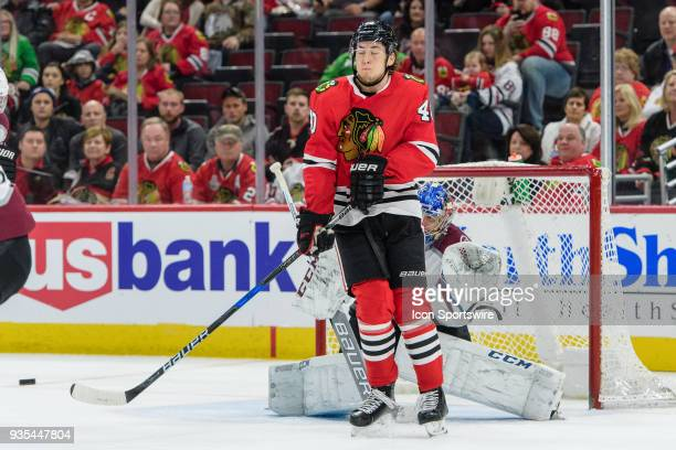 Chicago Blackhawks center John Hayden reacts to a Chicago Blackhawks shot while standing in front of Colorado Avalanche goalie Semyon Varlamov in the...