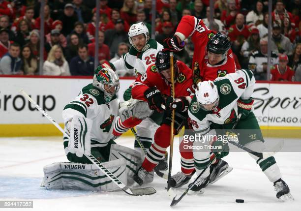 Chicago Blackhawks center Jonathan Toews and Artem Anisimov can't get to a puck in front of Minnesota Wild goalie Alex Stalock and defenseman Jared...