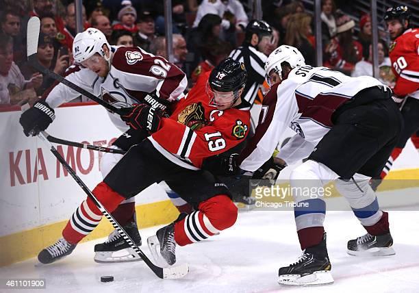 Chicago Blackhawks center Jonathan Toews battles Colorado Avalanche left wing Gabriel Landeskog and defenseman Brad Stuart during the first period on...