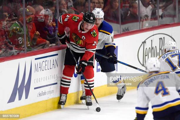Chicago Blackhawks center Jonathan Toews battles with St Louis Blues center Brayden Schenn for a loose puck in the second period of play during a...