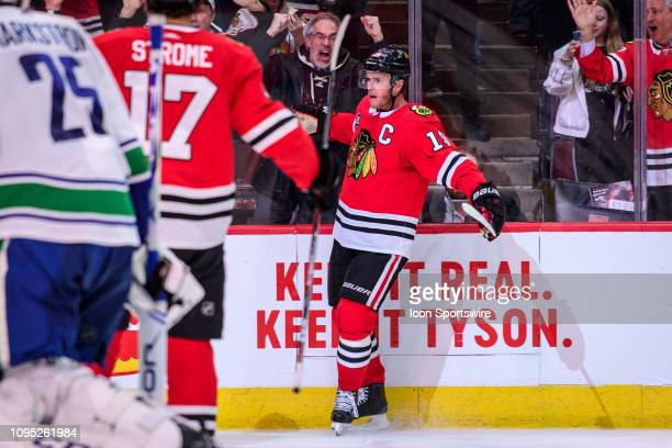 Chicago Blackhawks center Jonathan Toews celebrates his game winning overtime goal after an NHL hockey game between the Vancouver Canucks and the...