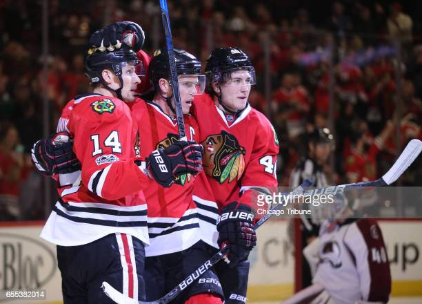 Chicago Blackhawks center Jonathan Toews celebrates his goal with Richard Panik and John Hayden against Colorado Avalanche goalie Jeremy Smith in the...