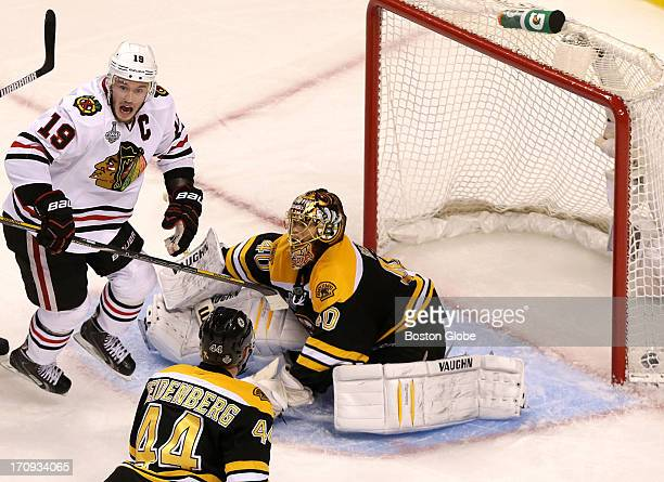 Chicago Blackhawks center Jonathan Toews reacts after a shot from Chicago Blackhawks defenseman Brent Seabrook , not pictured, got past Boston Bruins...