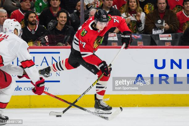 Chicago Blackhawks center Kirby Dach shoots the puck in the first period during an NHL hockey game between the Carolina Hurricanes and the Chicago...