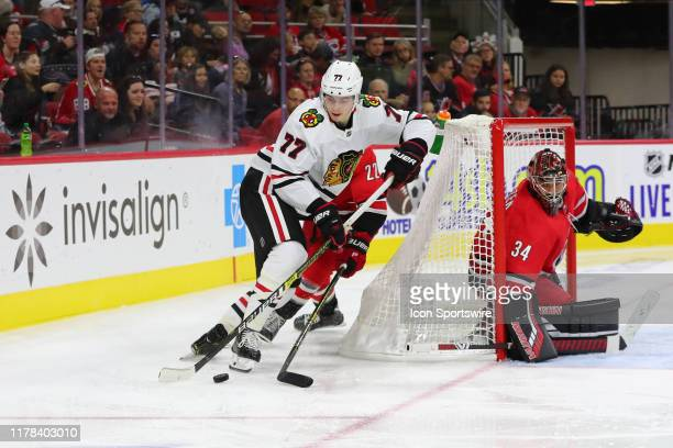 Chicago Blackhawks center Kirby Dach with the puck while Carolina Hurricanes goaltender Petr Mrazek watches during the 2nd period of the Carolina...