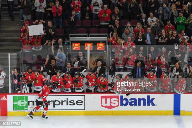 Chicago Blackhawks center Nick Schmaltz celebrates a goal with the bench as a fan holds a sign up for his birthday during a game between the Chicago...