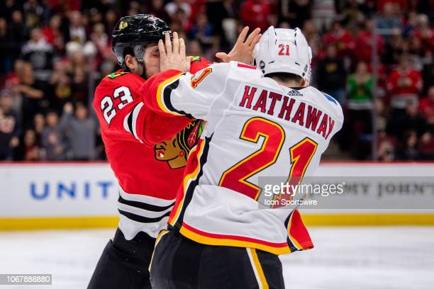 Chicago Blackhawks defenseman Brandon Manning and Calgary Flames right wing Garnet Hathaway fight during a game between the Calgary Flames and the...