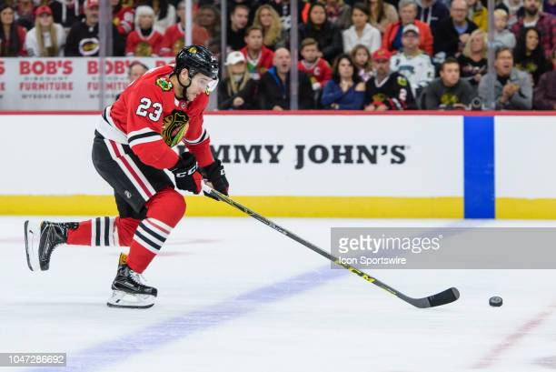 Chicago Blackhawks defenseman Brandon Manning skates with the puck in the 1st period during an NHL hockey game between the Toronto Maple Leafs and...