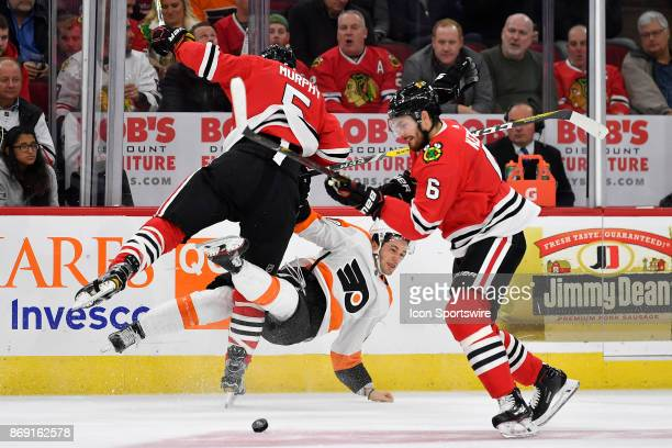 Chicago Blackhawks defenseman Connor Murphy collides with Philadelphia Flyers left wing Taylor Leier during a game between the Chicago Blackhawks and...