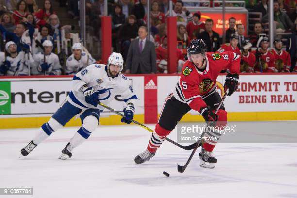 Chicago Blackhawks defenseman Connor Murphy controls the puck against Tampa Bay Lightning right wing Nikita Kucherov in the first period during a...