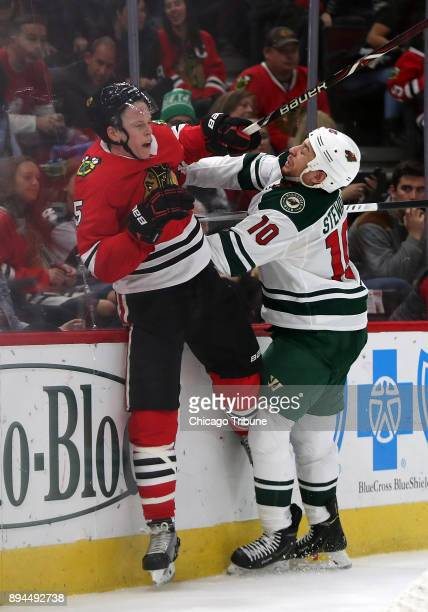 Chicago Blackhawks defenseman Connor Murphy gets hit by Minnesota Wild right wing Chris Stewart in the second period on Sunday Dec 17 2017 at the...
