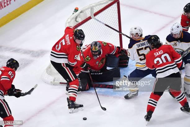 Chicago Blackhawks defenseman Connor Murphy helps Chicago Blackhawks goaltender Corey Crawford in blocking a shot in game action during a NHL game...