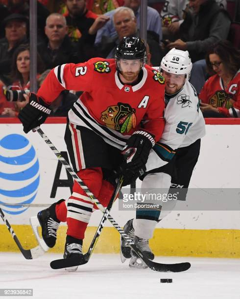 Chicago Blackhawks defenseman Duncan Keith controls the puck against San Jose Sharks center Chris Tierney during a game between the Chicago...