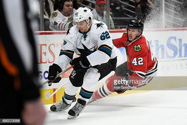Chicago Blackhawks defenseman Gustav Forsling losses control next to San Jose Sharks right wing Kevin Labanc in the second period during a game...