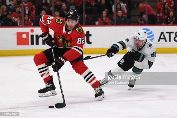Chicago Blackhawks defenseman Jordan Oesterle controls the puck against San Jose Sharks left wing Mikkel Boedker in the second period during a game...