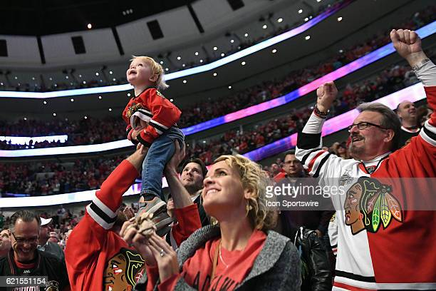 Chicago Blackhawks fans celebrate a goal in the second period during a game between the Chicago Blackhawks and the Dallas Stars on November 6 at the...