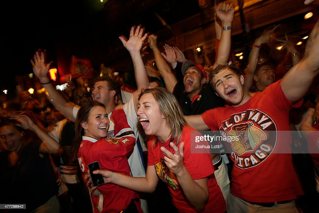 Chicago Blackhawks fans celebrate after Game Six of the Stanley Cup Finals against the Tampa Bay Lightning June 15, 2015 in Chicago, Illinois. The Blackhawks defeated the Lighting 2-0 to win the Stanley Cup.