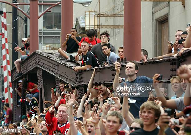 Chicago Blackhawks fans crowd Washington Avenue near Wacker Drive before the start of the victory parade for the team in Chicago Illinois Friday June...