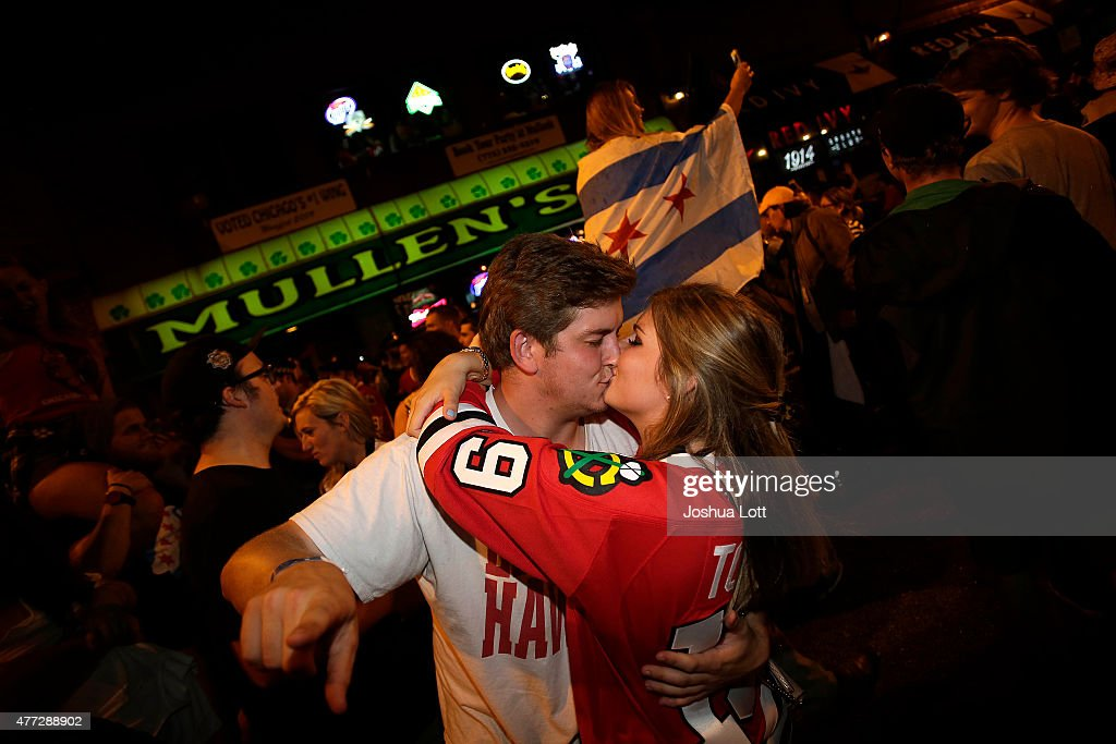 Chicago Blackhawks fans kiss as they celebrate after Game Six of the Stanley Cup Finals against the Tampa Bay Lightning June 15, 2015 in Chicago, Illinois. The Blackhawks defeated the Lighting 2-0 to win the Stanley Cup.