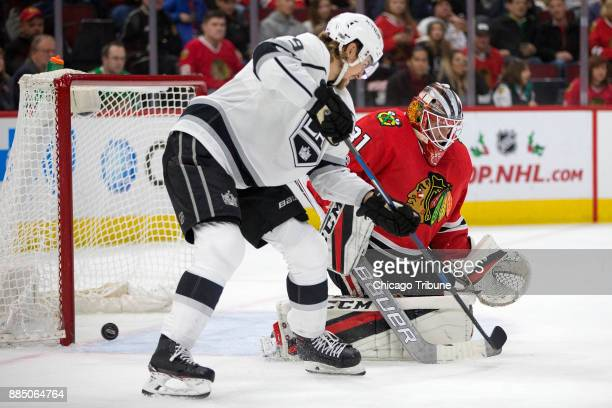 Chicago Blackhawks goalie Anton Forsberg blocks a shot from Los Angeles Kings left wing Adrian Kempe during the second period on Sunday Dec 3 at the...
