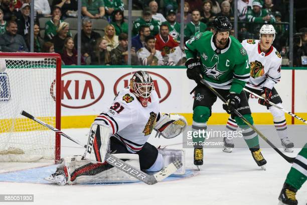 Chicago Blackhawks goalie Anton Forsberg tends net as Dallas Stars left wing Jamie Benn waits for the puck during the game between the Dallas Stars...