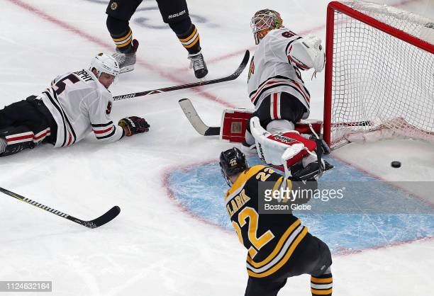 Chicago Blackhawks goalie Collin Delia is down and out as is defenseman Connor Murphy at left giving the Bruins' Peter Cehlarik a wide open net to...