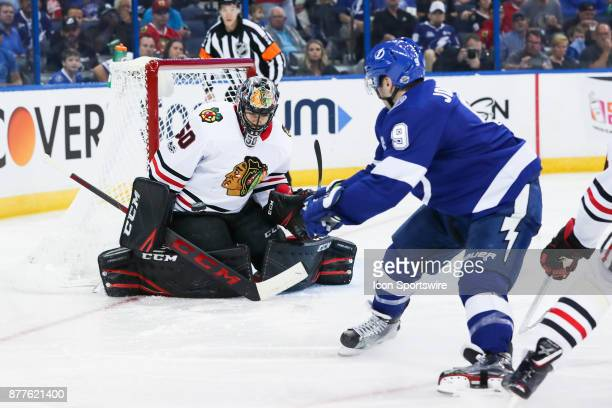 Chicago Blackhawks goalie Corey Crawford blocks the shot from Tampa Bay Lightning center Tyler Johnson with his body in the 2nd period of the NHL...