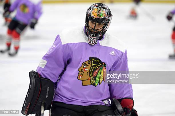 Chicago Blackhawks goalie Corey Crawford warms up in a lavender jersey in honor of 'Hockey Fights Cancer' night prior to the game between the Chicago...