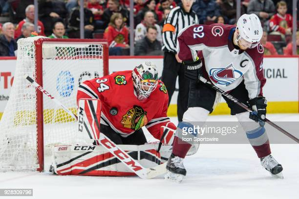 Chicago Blackhawks goalie JeanFrancois Berube stop a puck with his chest as Colorado Avalanche left wing Gabriel Landeskog stands in front of the...