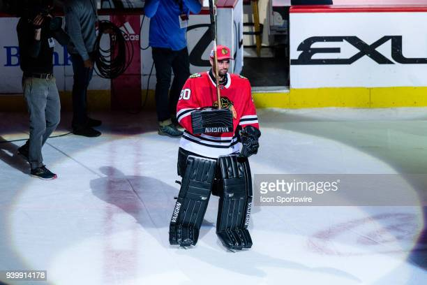 Chicago Blackhawks goalie Scott Foster serving as emergency goalie after signing a one day amateur tryout contract skates after being named number...