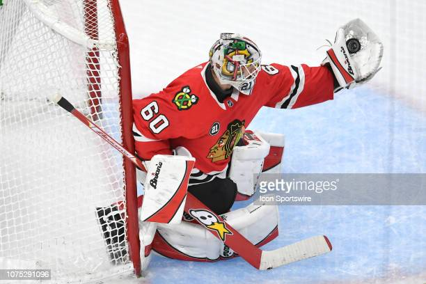Chicago Blackhawks goaltender Collin Delia makes a glove save in third period action during a game between the Chicago Blackhawks and the Minnesota...