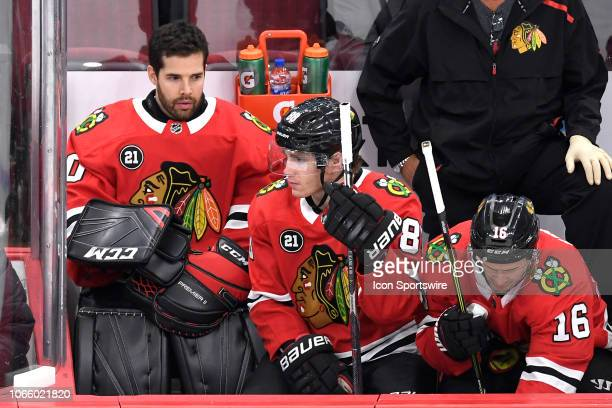Chicago Blackhawks goaltender Corey Crawford look on from the bench in third period action during a NHL game between the Chicago Blackhawks and the...