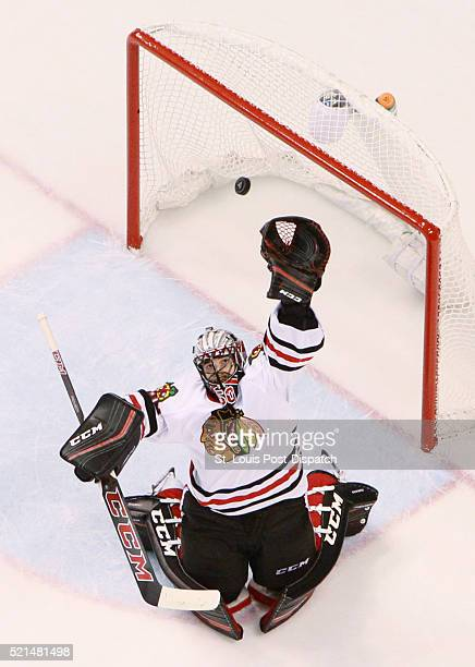 Chicago Blackhawks goaltender Corey Crawford reaches for a high puck in the second period against the St Louis Blues during Game 2 of the Western...